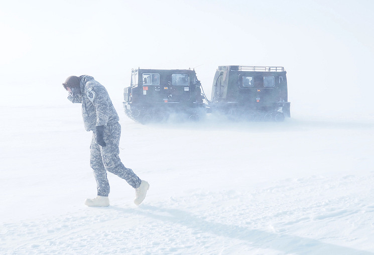 A Soldier belonging to Headquarters and Headquarters Company, 297th Battlefield Surveillance Brigade, braves whiteout conditions, April 4, 2016, in a field near Barrow, Alaska. Blowing snow, often moving at up to 50 mph, made navigations and operations difficult during the daylong trek through the arctic. (U.S. Army National Guard photo by Sgt. David Bedard)