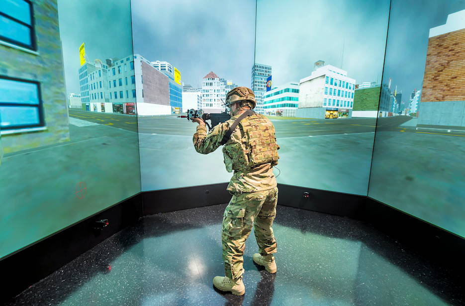 A Soldier navigates through the augmented reality lab at the Center for Applied Brain and Cognitive Sciences, a cooperative research initiative between Tufts University School of Engineering and CCDC's Soldier Center on October 5, 2016. The center conducts applied research on measuring, predicting and enhancing cognitive capabilities and human system interactions for individuals and teams working in high-stakes environments.(U.S. Army photo by David Kamm, CCDC Soldier Center)
