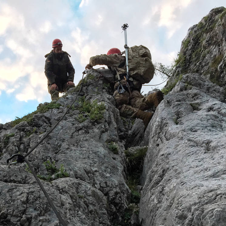 July 27, 2016 - A Bundeswehr soldier helps a comrade from the U.S. Army 18th Military Police Brigade to the summit during a ropes training exercise conducted as part of exercise Alpinedistel 2016. The two-day German mountain warfare training exercise took place July 20-21 and July 27-28 here. It's designed to challenge the physical and mental toughness of the soldiers ... as well as prove their proficiency in mountain operations. (U.S. Army photo by Staff Sgt. Frank Brown Jr., 18th Military Police Brigade Public Affairs)