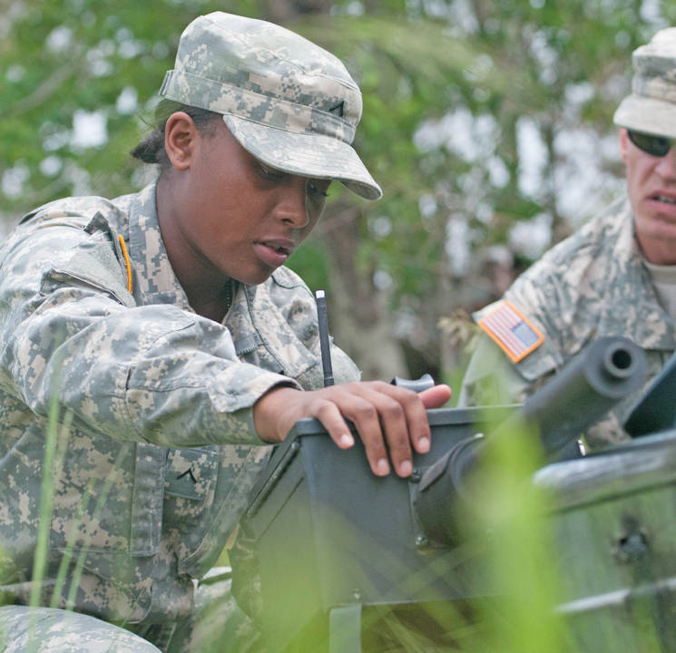 April 30, 2016 - Private Selena Moore, human resources specialist with the 518th Sustainment Brigade, explains the XM-2 simulator to Staff Sgt. Joshua Owens, a drill sergeant with the 108th Training Command, at Range 68 at Fort Bragg, NC in preparation for the 2016 U.S. Army Reserve Best Warrior Competition May 2-5. This year's Best Warrior Competition will determine the top noncommissioned officer and junior enlisted Soldier who will represent the U.S. Army Reserve in the Department of the Army Best Warrior Competition later this year at Fort A.P. Hill, Va. (U.S. Army photo by Sgt. Christina Dion)