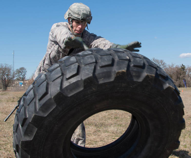 U.S. Air Force Tech. Sgt. Steven Hein, a competitor from the 136th Security Forces Squadron, conducts a tire flip as part of the mystery event portion of the Best Warrior Competition at Camp Swift, Texas on Feb. 6, 2016. The BWC test the aptitude of elite Texas Air and Army National Guardsmen in events relevant to today's operating environment. (Texas Air National Guard photo by USAF Tech. Sgt. Vanessa Ree)