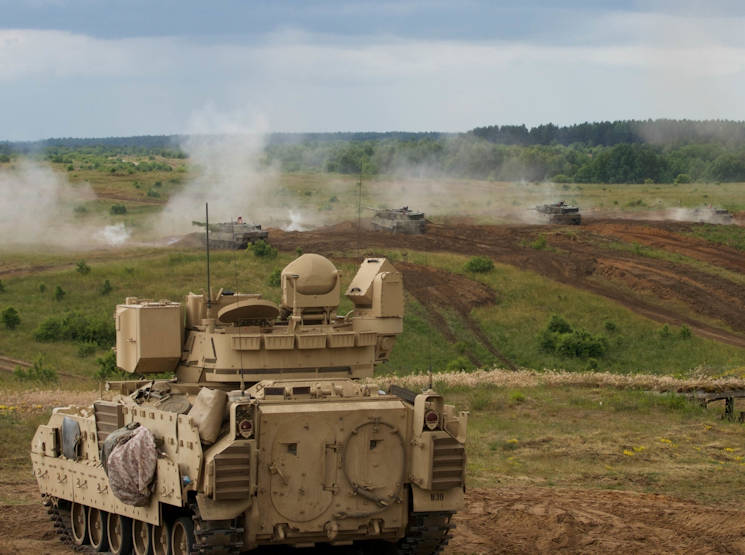 "U.S. Army Soldiers participating in Saber Strike 15 conduct a combined arms live-fire exercise June 19, 2015 at the Drawsko Pomorskie Training Area in Poland. The U.S. military in Europe is prepared to defend its NATO allies against Russian aggression. Thus far, however, Russian aggression against Ukraine and other non-NATO border nations has been in the form of asymmetric warfare, aka ""gray zone"" warfare. (U.S. Army photo by Spc. Marcus Floyd)"