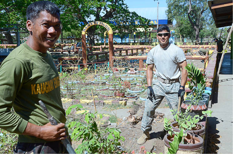 April 9, 2016 - A soldier with the Armed Forces of the Philippines and a U.S. Soldier with Company B, 2nd Battalion, 3rd Infantry Regiment, 1-2 Stryker Brigade Combat Team, help dig a trench for a local school in the Philippines. This was part of Balikatan 2016, which is an annual bilateral training exercise between U.S. and Armed Forces of the Philippine that promotes regional stability and security. (U.S. Army photo by Spc. Loren Keely)