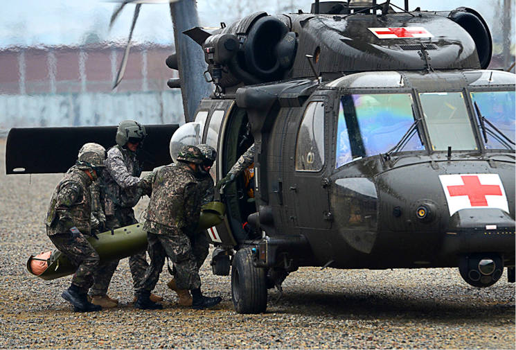 March 15, 2016 - A Republic of Korea soldiers from the ROK army 137th Infantry, and U.S. Soldiers from 1-2 Stryker Brigade Combat Team, load a casualty into a black hawk as part of medical evacuation training at Rodriguez Live Fire Complex, South Korea. The Soldiers of 1-2 Stryker Brigade Combat Team conducted combined hoist and medevac training with the Soldiers of 3-25 Aviation Battalion and ROK soldiers as part of Operation Pacific Pathways. (U.S. Army photo by Spc. Loren Keely)