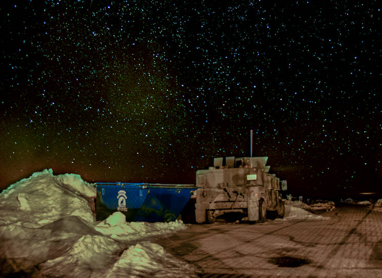 February 8, 2016 - A 90th Missile Security Forces Squadron Humvee sits on the access road of a Missile Alert Facility in the F.E. Warren Air Force Base, Wyo., missile complex, in this composite of two photos. Security forces, missileers and other 90th Missile Wing Airmen stay vigilant 24/7. (U.S. Air Force photo illustration by Senior Airman Jason Wiese)
