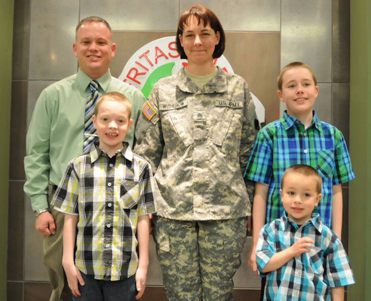 April 3, 2015 - U.S. Army Reserve Sgt. Rachelle Witherow with her husband, U.S. Army Reserve Staff Sergeant Bryan Witherow and their three sons after Rachelle's promotion ceremony at the 88th RSC Headquarters on Fort McCoy, Wisconsin. (U.S. Army Reserve photo courtesy of Sgt. 1st Class Corey Beal)