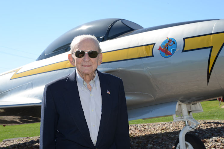 "World War II Veteran and former Air National Guard Wing Commander, Col. Warren ""Bud"" Nelson (Ret.), stands in front of a U.S. Air Force F-80 Shooting Star, he once piloted as a member of the Iowa Air National Guard. Nelson is visiting his old unit, the 185th Air Refueling Wing, during a 70th anniversary open house event in Sioux City, Iowa on September 10, 2016. (U.S. Air Force photo by U.S. Air Force Master Sgt. Vincent De Groot, Iowa Air National Guard)"