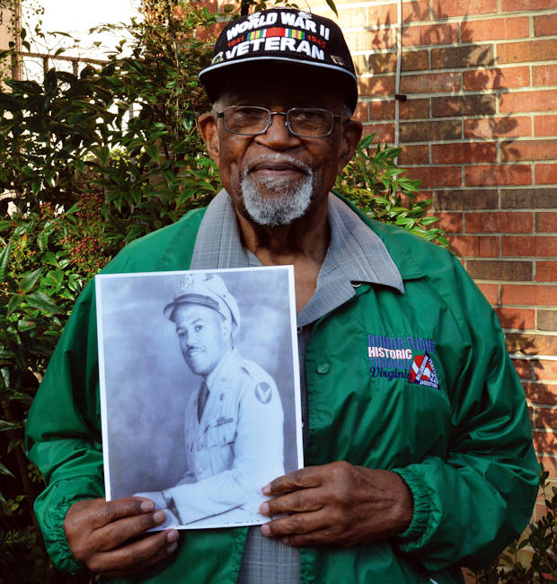 Oct. 4, 2016 - U.S. Army Ret. Lt. Col. Louis Martin, 99, holds a photograph that was taken while he served as an Army quartermaster officer during World War II. (U.S. Army photo by Lesley Atkinson, Garrison Fort Lee PA)