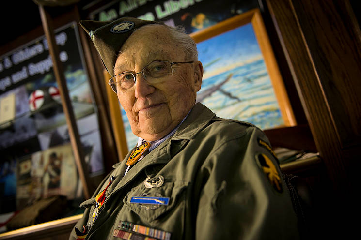 February 18, 2016 - U.S. Army Private 1st Class (Sep.) Lynn Aas, 17th Airborne Division combat infantry rifleman, poses for a photo at the Dakota Territory Air Museum in Minot, ND. Aas served during the Battle of the Bulge and was awarded the Bronze Star and Purple Heart for his sacrifices. (U.S. Air Force photo by Senior Airman Apryl Hall)