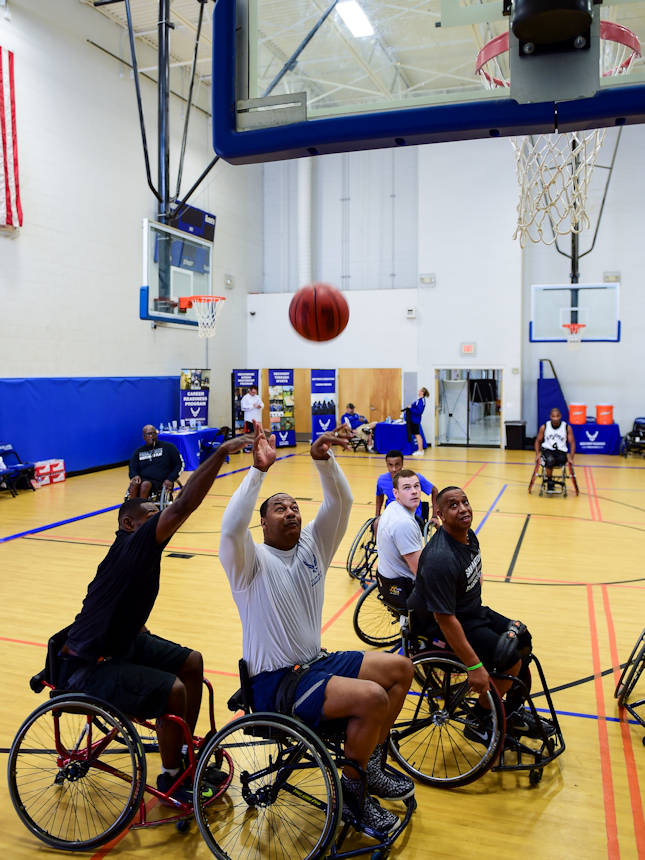 U.S. Air Force Tech. Sgt. Darrell Davis II, a supervisor with the 59th Medical Wing Airman Medical Transition Unit, shoots to score during the Adaptive and Rehabilitative Sports Kick-Off Oct. 9, 2015, on Joint Base San Antonio-Lackland. The Airman Medical Transition Unit provides administrative oversight and supervision to more than 50 Airmen recovering from combat and non-combat related injuries and illnesses. (U.S. Air Force photo by Staff Sgt. Michael Ellis)