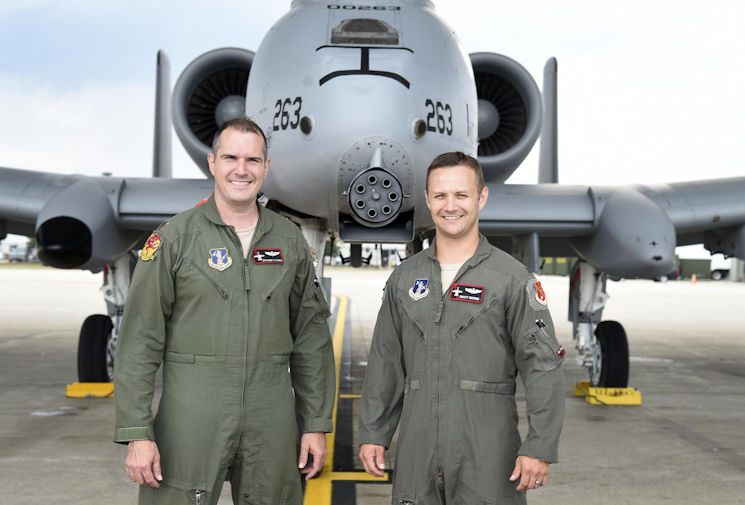 Capt. Brett DeVries (right) and his wingman Maj. Shannon Vickers, both A-10 Thunderbolt II pilots of the 107th Fighter Squadron from Selfridge Air National Guard Base, Mich. Vickers helped DeVries safely make an emergency landing July 20, 2017 at the Alpena Combat Readiness Training Center after the A-10 DeVries was flying experienced a malfunction. (Air National Guard photo by Terry Atwell)