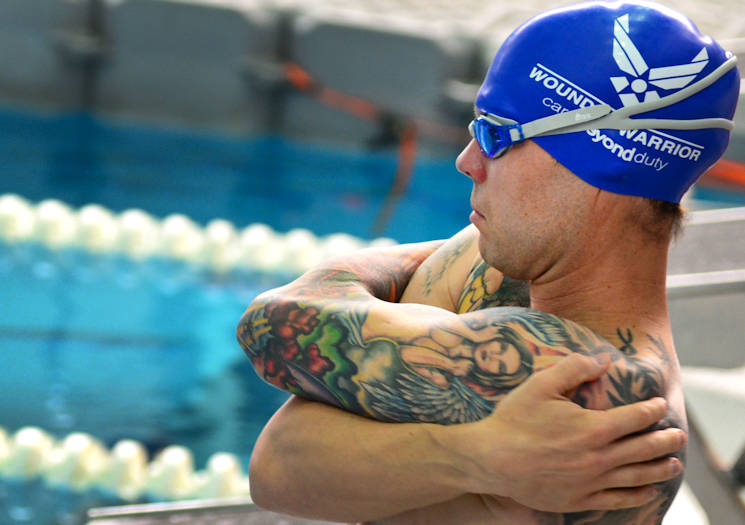 July 8, 2017 - U.S. Air Force veteran Rob Scoggins, a former combat rescue helicopter pilot from Manitou Springs, Colorado takes a moment to stretch before his race at the 2017 Department of Defense Warrior Games at the University of Illinois in Chicago. Scoggins competed in the men's 50-meter freestyle. (U.S. Air Force photo by Staff Sgt. Alexx Pons)