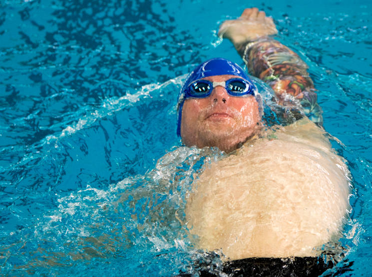 July 8, 2017 - U.S. Air Force veteran Rob Scoggins, a former combat rescue helicopter pilot from Manitou Springs, Colorado swims during the men's 50-yard backstroke at the 2017 Warrior Games at the University of Illinois in Chicago. Adaptive sports provide unique opportunities for athletes to heal and regain confidence and purpose, while the Warrior Games offer a way to celebrate efforts and commitment to healing. (U.S. Air Force photo by Staff Sgt. Keith James)