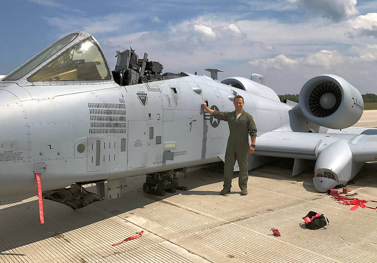 Capt. Brett DeVries, an A-10 Thunderbolt II pilot of the 107th Fighter Squadron from Selfridge Air National Guard Base, poses next to the aircraft he safely landed after a malfunction forced him to make an emergency landing July 20, 2017 at the Alpena Combat Readiness Training Center. (Air National Guard photo by Terry Atwell)