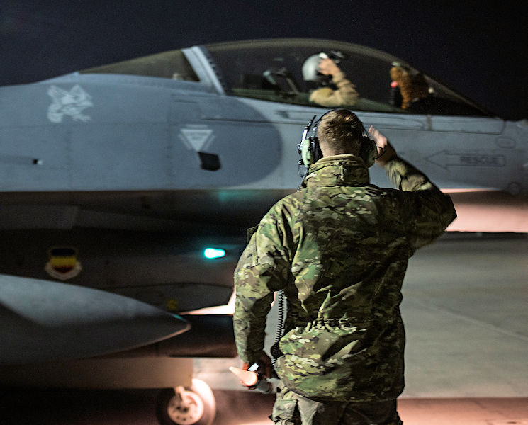 January 13, 2017 - U.S. Air Force Capt. David, 79th Expeditionary Fighter Squadron pilot, and U.S. Air Force Staff Sgt. Daniel Lasal, 455th Expeditionary Aircraft Maintenance Squadron dedicated crew chief, salute one another before a night mission at Bagram Airfield, Afghanistan. David enlisted in the Air Force in 2004 as an F-16 Fighting Falcon avionics specialist and now flies the same airframe he used to be a maintainer for. (U.S. Air Force photo by Staff Sgt. Katherine Spessa)