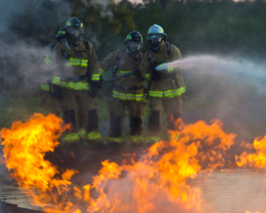 August 11, 2017 - U.S. Air Force firefighters with the 944th Civil Engineer Squadron, Luke AFB, Ariz., 445th Civil Engineer Squadron, Wright Patterson AFB, Ohio, 932nd Civil Engineer Squadron, Scott Air Force Base, Ill., and the 910th Civil Engineer Squadron, Youngstown, Ohio, conduct fire pit training during exercise Patriot Warrior at Sparta/Fort McCoy Airport, Wisconsin. Patriot Warrior is an Air Force Reserve training exercise designed to enhance wartime skills in a deployment-style environment and evaluate the ability of units to deploy mobility airlift and agile combat support capabilities in support of joint theater operations. (U.S. Air Force photo by Tech. Sgt. Efren Lopez)