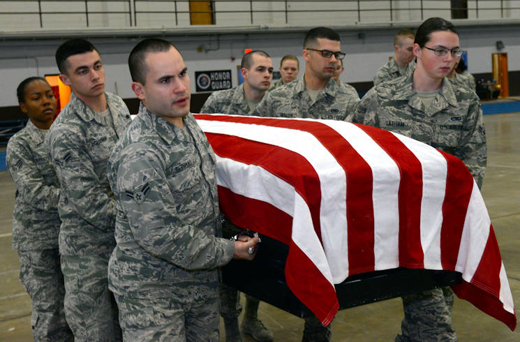 October 26, 2017 - Airmen assigned to the Ellsworth Air Force Base, S.D., Honor Guard, carry a casket during a training exercise in the United States Air Force Honor Guard Mobile Training Team event at the Pride Hangar on base. The honor guard flight underwent a week-and-a-half long course in basic protocol, honors and ceremonies. (U.S. Air Force photo by Airman Nicolas Z. Erwin)