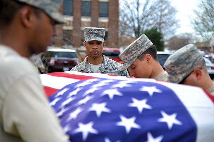 March 1, 2017 - U.S. Air Force Staff Sgt. Quinton Gittens, 633rd Force Support Squadron readiness NCO in charge, assesses the honor guard team during training at Joint Base Langley-Eustis, VA. The team practiced a detail that would be performed during a funeral service. (U.S. Air Force photo by Airman 1st Class Tristan Biese)