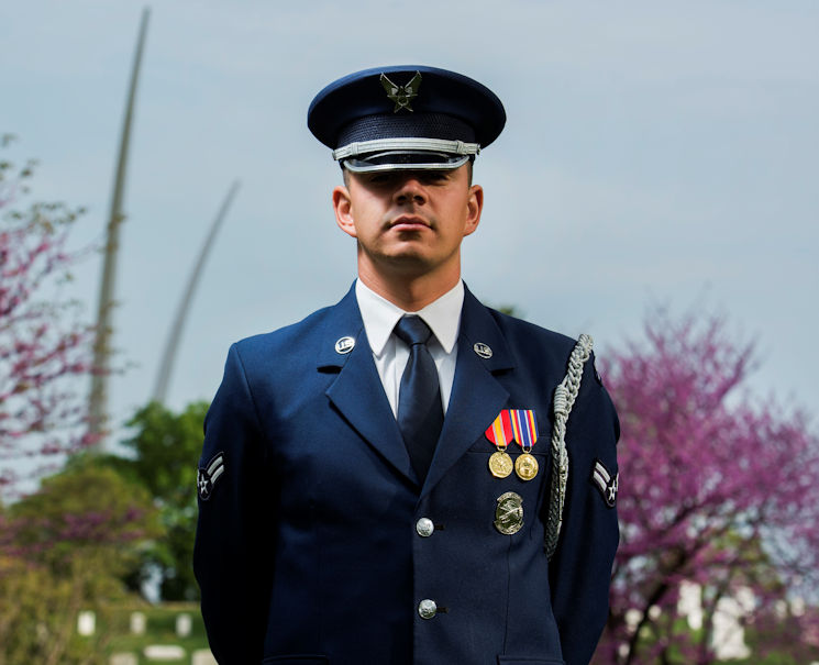 April 15, 2017 - Airman 1st Class Jose Velazquez, U.S. Air Force Honor Guard firing party member, stands in an Air Force ceremonial uniform at Arlington National Cemetery in Arlington, VA. Velazquez came to America from Mexico at a young age and dreamed of joining the military. (U.S. Air Force photo by Senior Airman Philip Bryant)