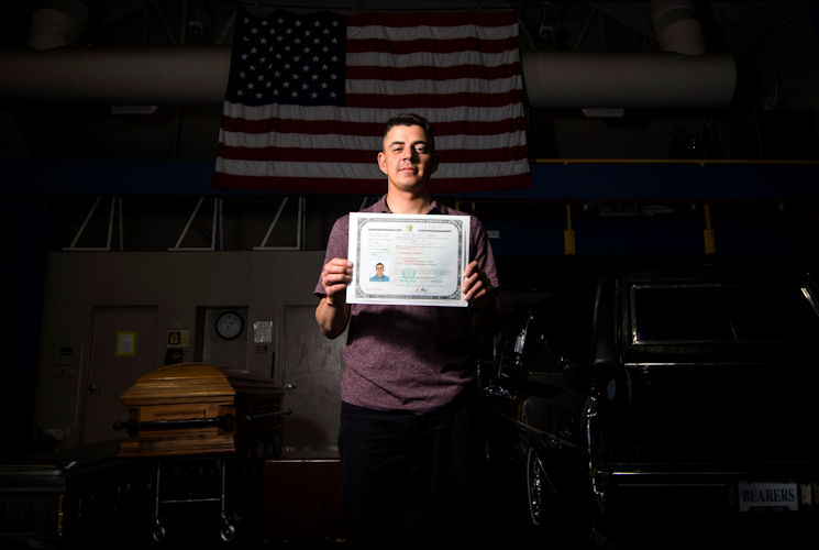 April 20, 2017 - Jose Velazquez, U.S. Air Force Honor Guard firing party member, holds his citizenship paperwork inside Ceremonial Hall at Joint Base Anacostia-Bolling, District of Colombia. Velazquez came to America with his parents at a young age and gained citizenship after completing Air Force basic training. (U.S. Air Force photo by Senior Airman Philip Bryant)