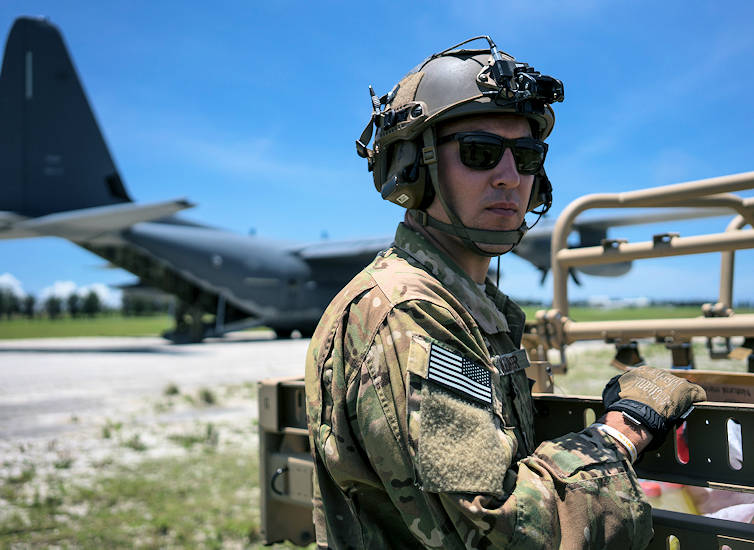 June 22, 2017 - U.S. Air Force Tech. Sgt. Kade Bollinger preparing to support the rapid infiltration and exfiltration of a tactical vehicle during a mass launch training mission at Ie Shima Range, Okinawa, Japan. (U.S. Air Force photo by Capt. Jessica Tait)