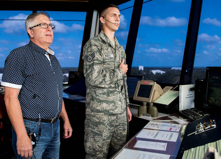 October 4, 2017 - Steven Kates (left) watches the Duke Field airspace as Staff Sgt. Brian Morris, 96th Operations Group, communicates with an aircraft at the air traffic control tower. Kates, a tower watch supervisor and controller for 37 years, trained Morris's father in ATC in the early nineties. This year, he also helped train Morris and supervised his tower certification. (U.S. Air Force photo by Samuel King)