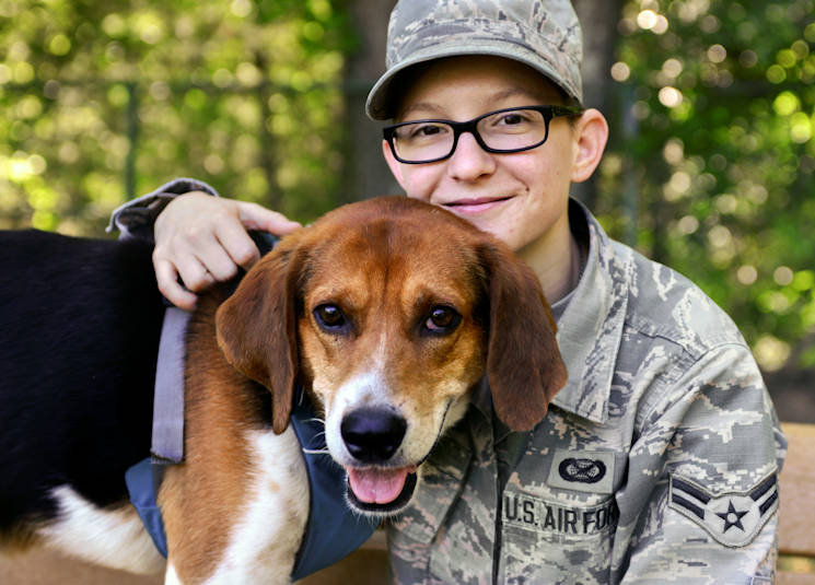 "U.S. Air Force Airman 1st Class Kaylee Dubois, 633rd Air Base Wing Public Affairs photojournalist, spends time with her dog, Watson, at Joint Base Langley-Eustis, Virginia on May 9, 2017. Dubois spent roughly seven months in mental health treatment programs, and once she was successful in managing her own recovery process, she adopted a rescued dog, who now aids in her ""self treatment"". (U.S. Air Force photo by Tech. Sgt. Katie Gar Ward)"