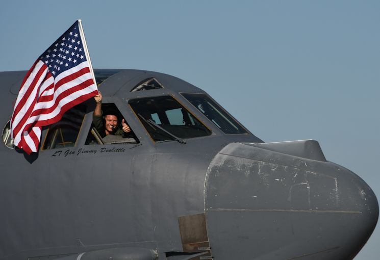 March 3, 2017 - U.S. Air Force Lt. Col. Brent Weisner, 93rd Bomb Squadron commander waves the U.S. flag and gives a thumbs-up prior to takeoff at Barksdale Air Force Base, LA. The gestures by Weisner signified the historic nature of the flight which gave Lt. Col. Steve Smith, 93rd BS flight instructor, more than 10,000 flight hours in the B-52 Stratofortress. Smith has more hours in the B-52 than any other current member of the Air Force. (U.S. Air Force photo by Tech. Sgt. Ted Daigle)