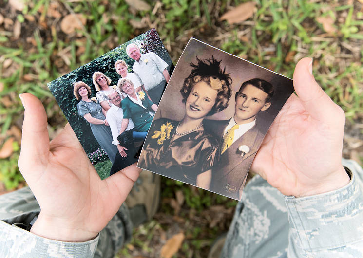 March 22, 2017 - U.S. Air Force Maj. Marnee A.C. Losurdo, 403rd Wing Public Affairs chief at Keesler Air Force Base, Mississippi holds photographs of her grandmother and grandfather with family members. (U.S. Air Force photo by Staff Sgt. Heather Heiney)