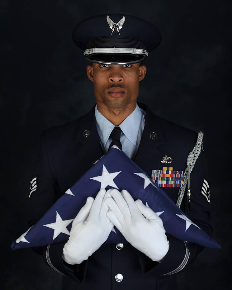 February 27, 2017 - U.S. Air Force Staff Sgt. Quinton Gittens, 633rd Force Support Squadron readiness NCO in charge respectfully holds a folded American flag at Joint Base Langley-Eustis, VA. Gittens won the 2016 9th Air Force Program Manager of the Year as the Langley Honor Guard manager. (U.S. Air Force photo by Airman 1st Class Tristan Biese)