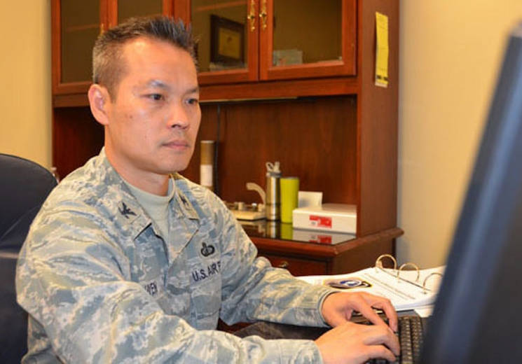 "January 4, 2017 - U.S. Air Force Col. Quy Nguyen is the budget execution and analysis branch chief for the Air Force Installation and Mission Support Center. His ability to focus on the task at hand and stay positive impresses Maj. Edith Coon, AFIMSC chief of financial operations and integration. ""He's very good at balancing family and work,"" Coon said. (U.S. Air Force photo by James J. Truitt)"