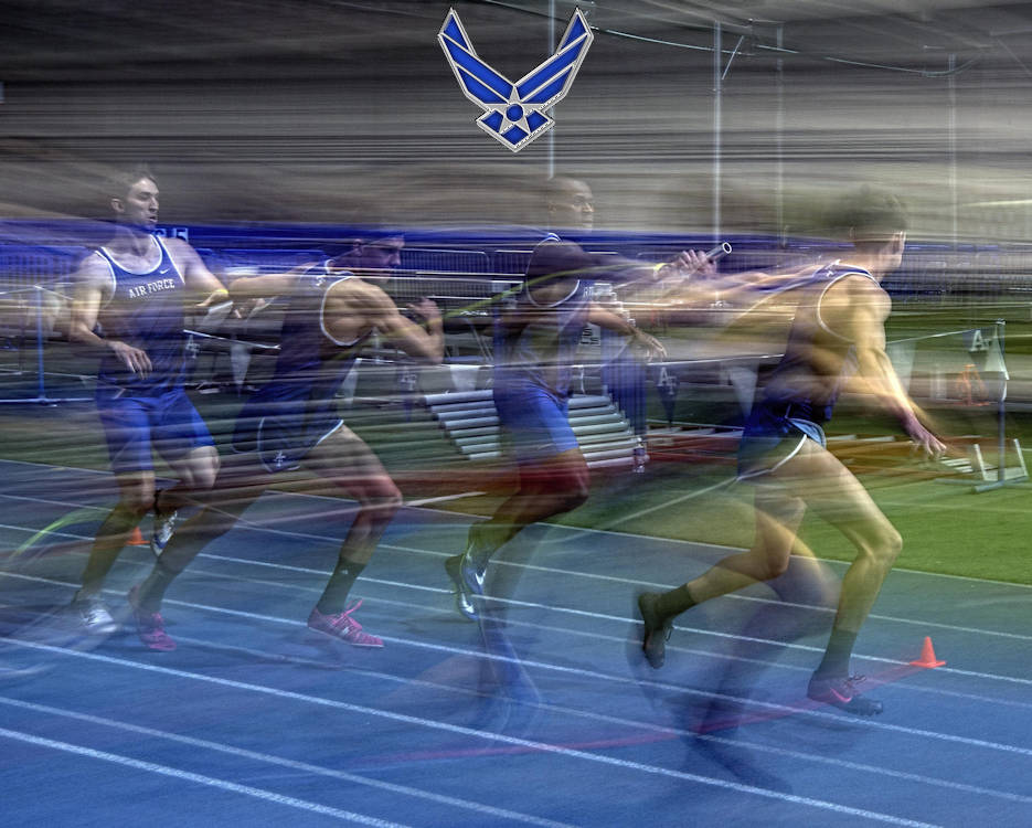 January 21, 2017 - Two Air Force teams hand off their batons during the mile relay at the 27th annual Air Force Invitational at the U.S. Air Force Academy's Cadet Field House in Colorado Springs, Colorado. The Falcons fielded five teams, grabbing the top two positions, with the Colorado Buffs finishing in third place. (U.S. Air Force photo by Bill Evans)