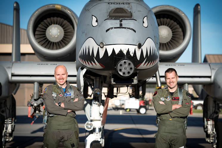 April 8, 2017 - Maj. Matthew Shelly, 23 Wing director of inspections, left, and Capt. Christopher Shelly, 76th Fighter Squadron chief of standards and evaluations stand proudly in front of with an A-10C Thunderbolt II at Moody Air Force Base, GA. The brothers flew in formation together for the first time, fulfilling their childhood dream while also contributing to total force integration, the use of multiple components of the Air Force, which can include active duty, reserve or guard. (U.S. Air Force photo by Airman 1st Class Lauren M. Sprunk)