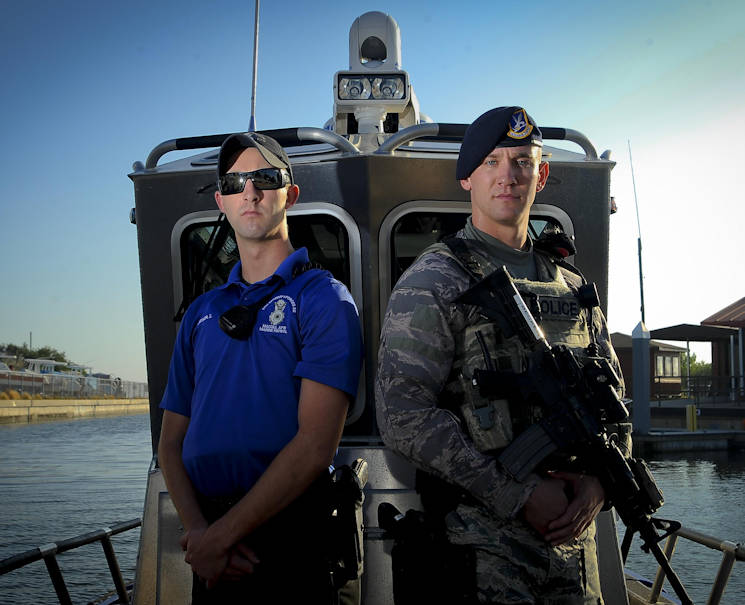 December 14, 2016 - Senior Airman Zade Becker, left, a marine patrolman with the 6th Security Forces Squadron (SFS), and his brother Senior Airman Austin Becker, right, an emergency services team operator with the 6th SFS, pose for a photo at MacDill Air Force Base Florida. The Becker brothers are currently stationed together at MacDill and defend the base as security forces members. (U.S Air Force photo by Airman 1st Class Mariette Adams)