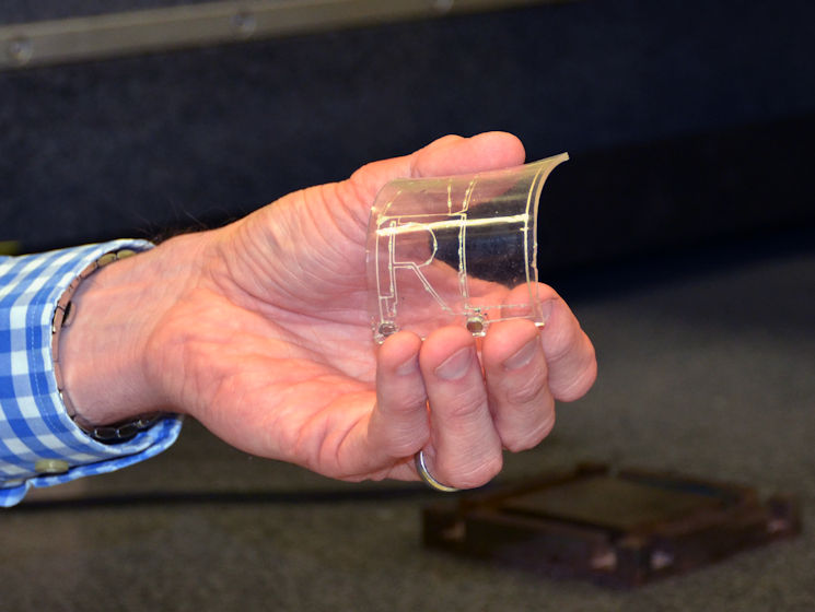 August 9, 2017 - A member of the Flexible Materials and Processes team at the Air Force Research Laboratory's Materials and Manufacturing Directorate exhibits an additively manufactured electrical circuit embedded in a flexible material substrate. The flex team is exploring novel ways to use 3-D printing technology to create next generation flexible hybrid technologies for the Air Force. (U.S. Air Force photo by Marisa Alia-Novobilski)