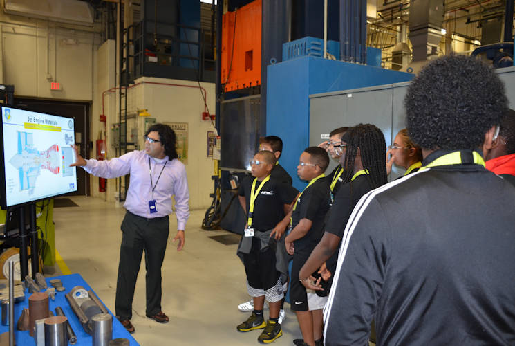 June 30, 2017 - LEGACY (Leadership Experience Growing Apprenticeships Committed to Youth) students toured the AFRL Materials and Manufacturing Directorate labs as part of the program's Craftsman camp events. Directorate volunteers participated in the camps this summer to promote youth interest in STEM-related fields. (U.S. Air Force photo by Marisa Alia-Novobilski, AFRL)