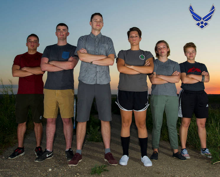 July 1, 2017- From Left: Senior Airmen Christopher Velazquez, Justin Valentine, Jake Nixon, Airmen 1st Class Kayla Loftis, Hannah and Allie Staffen (Airman 1st Class Logan Oldenburg not pictured) ... helped rescue a man from a bison attack during a camping trip in Theodore Roosevelt National Park's North Unit, ND. The group assessed the man's injuries and called for help, all while the bison loomed in the area. (Image created by USA Patriotism! from U.S. Air Force photo by Senior Airman Apryl Hall)