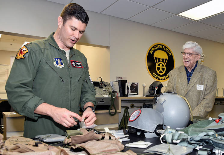March 15, 2016 - Major Bill Rundell, a pilot with the 107th Fighter Squadron, shows some of the life support equipment used by Air Force pilots to Philas Kelly, who served in the 107th prior to World War II, during a visit by Kelly to the squadron at Selfridge Air National Guard Base. (U.S. Air National Guard photo by Terry Atwell)