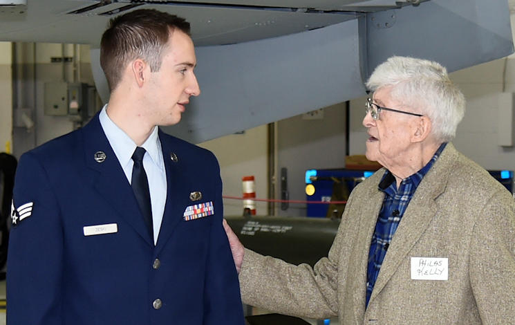 March 15, 2016 - Philas Kelly, at age 102 likely the oldest living former photographer to have served in the National Guard, talks with Senior Airman Ryan Zeski, the youngest photojournalist currently serving in the Michigan Air National Guard's 127th Wing at Selfridge Air National Guard Base. Kelly was recently a guest at the base to visit his old unit, now the 107th Fighter Squadron. (U.S. Air National Guard photo by Terry Atwell)