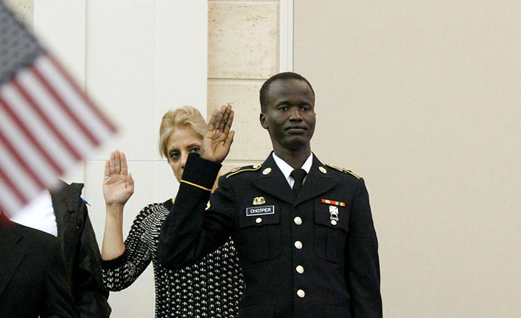 October 6, 2017 - Pfc. Fortytwo Chotper, a unit supply specialist with the 1168th Transportation Company, Iowa Army National Guard based in Perry, Iowa, earned his U.S. citizenship during a ceremony at the U.S. District Court of Southern Iowa in Des Moines, Iowa. Chotper, originally from Sudan, came to America from a refugee camp in Kenya and was eligible for accelerated citizenship through his service in the Iowa Army National Guard. (U.S. Army photo by National Guard SSgt. Christie Smith)