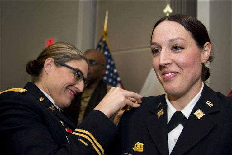 March 17, 2017 - Iowa Army National Guard Maj. Jill Finkel, left, pins a new gold leaf rank insignia on Massachusetts Army National Guard Maj. Molly Alesch during her promotion ceremony at Hanscom Air Force Base, MA. Finkel and Alesch are sisters and their youngest sister, Army Spc. Kristen Alesch, who serves in the Tennessee National Guard, also attended the promotion ceremony. (Massachusetts Army National Guard photo by Sgt. 1st Class Whitney Hughes)