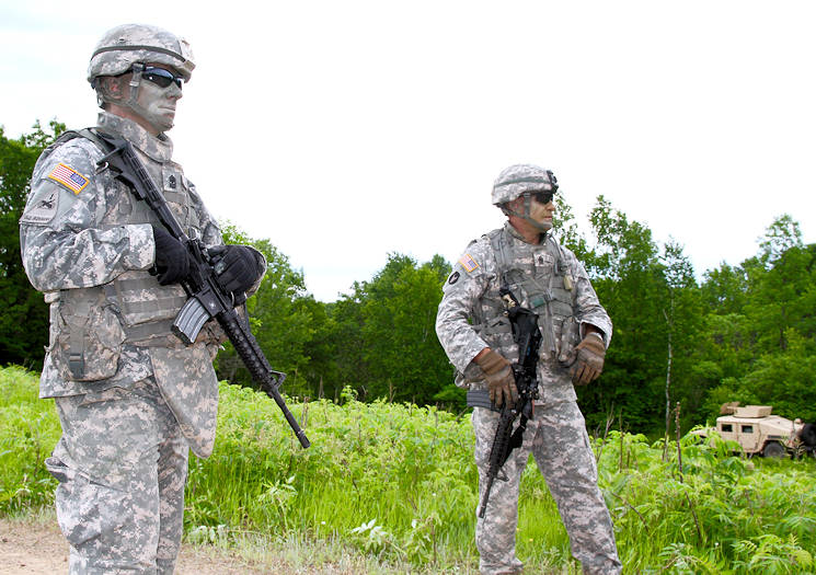 June 16, 2017 - Sgt. Maj. Jeremy Strasser, (left) Operations Sergeant Major, and his brother Command Sgt. Maj. Matthew Strasser, Command Sergeant Major, 1st Squadron,113th Cavalry, 2nd Brigade Combat Team, 34th Infantry Division, Iowa Army National Guard, oversee their cavalry troops in the field during annual training at Camp Ripley, Minnesosta. (Army National Guard photo by 1st Sgt. Sara Maniscalco Robinson)