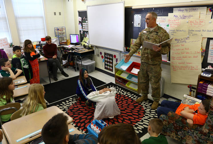 March 17, 2017 - U.S. Army Sgt. 1st. Class Edward Swiger, a 20-year veteran for the 20th Chemical, Biological, Radiological, Nuclear and Explosives Command, reads to a class of 4th-graders from one of his favorite books, the 'FM 7-22' also known as the 'Army Physical Training Manual' how to do a correct sit-up during Celebrity Reading Day at Churchville Elementary School. The event was part of the school's Reading Month festivities. (U.S. Army photo by Angel D. Martinez-Navedo)