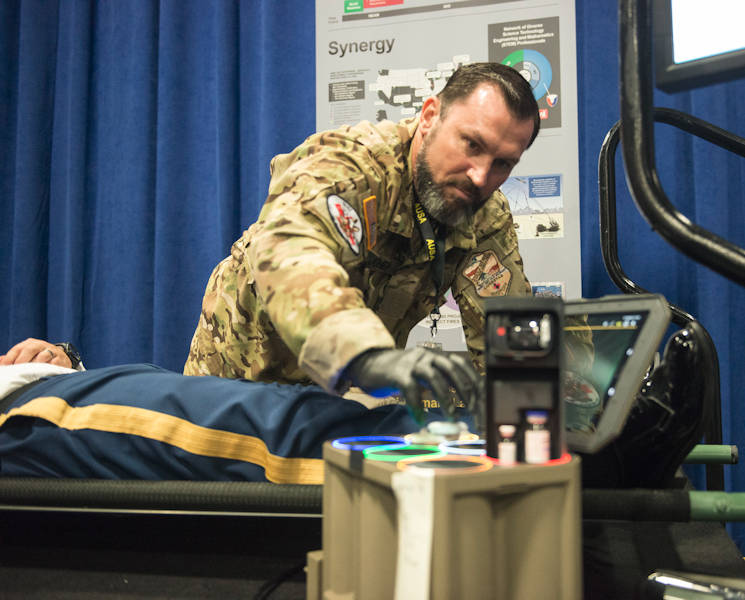 October 12, 2017 - U.S. Army Retired Sgt. 1st Class Jeffrey Jones demonstrates how to use the Medical Ultra Wideband Broadcast or MEDHUB system, which allows Army medics to tend to patients while recording data hands free. (U.S. Army photo by Joe Lacdan, ANS)