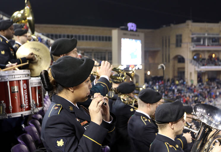 December 23, 2016 - The 1st Infantry Division Band plays to a live crowd during the 2016 Armed Forces Bowl at Amon C. Carter Stadium in Texas Christian University, Fort Worth, Texas. The band prefaced this performance with a smaller performance by their brass section at the ticket booth. (U.S. Army photo by Sgt. Michael Roach, 19th Public Affairs Detachment)