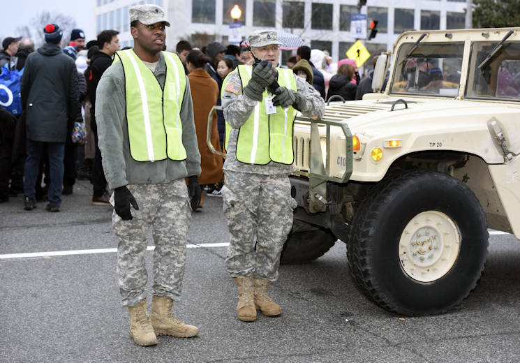 January 20, 2017 - Army Spc. Shaleek Blackman, left, with the Delaware Army National Guard's 153rd Military Police Company; and Army Staff Sgt. Eric Stunkard, with the Delaware Army Guard's 262nd Component Repair Company keep an eye out as crowds make their way to the National Mall for the 58th presidential inauguration in Washington, D.C. The soldiers were among more than 7,500 National Guard members from 44 states, territories and the District of Columbia who supported local authorities during the inauguration. Air Force photo by Tech. Sgt. Erich B. Smith (DoD News photo by U.S. Air Force Tech. Sgt. Erich B. Smith)