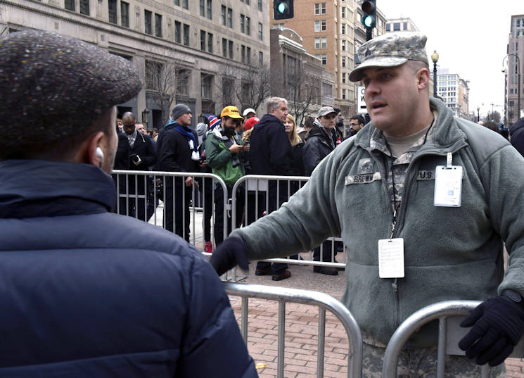 January 20, 2017 - Army Sgt. Kurtis Brown, a military police officer with the South Dakota Army National Guard's 235th Military Police Company, answers questions from a spectator near a checkpoint during the 58th presidential inauguration in Washington, D.C. Brown was one of more than 7,500 National Guard members from 44 states, territories and the District of Columbia who supported local authorities during the inauguration. (DoD News photo by U.S. Air Force Tech. Sgt. Erich B. Smith)