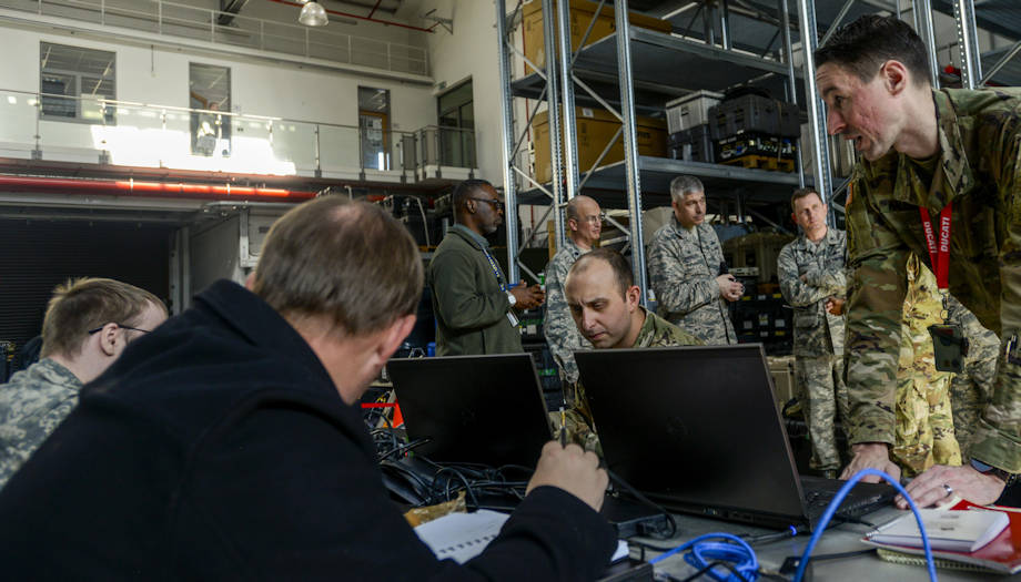 U.S. Army Staff Sgt. Matthew Malesinski, right, 201st Cyber Protection Team network security analyst, talks with his team during a cyber security audit of the 1st Combat Communications Squadron's tactical communications kits March 16, 2017, on Ramstein Air Base, Germany. The 1st CBCS requested the 201st CPT, which is part of the U.S. Army Cyber Protection Brigade, to test both the physical and internal security of their systems that allow them to set up and manage secure communications at deployed locations. (U.S. Air Force photo by Staff Sgt. Timothy Moore)