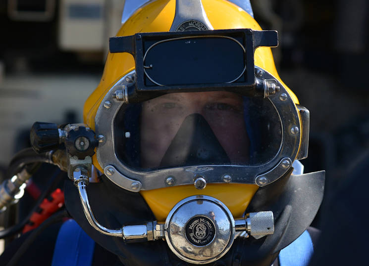March 22, 2016 - U.S. Army Spc. David Plummer, a second class diver assigned to the 569th Engineer Dive Detachment, prepares to surface-dive into the James River at Fort Eustis, VA. Plummer conducted a surface dive as part of upgrade training to become a salvage diver. (U.S. Air Force photo by Staff Sgt. Natasha Stannard)