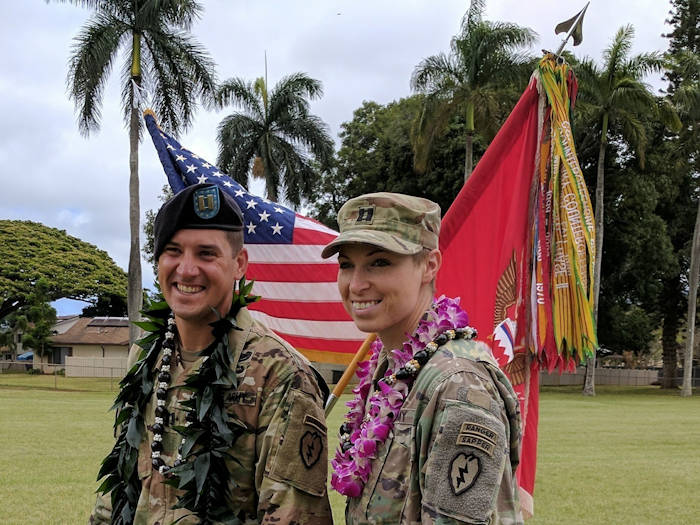 Capt. Natalie Mallue (right) and her husband Capt. Edward Mallue (left), pose for a photo after Edward's company change of command ceremony, Schofield Barracks, May, 2017. Natalie became the sixth female to graduate Ranger School in April 2017 and the first female to hold both Ranger and Sapper tabs. (Courtesy Photo)